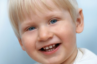 Child Smiling with following a pulpotomy that saved his tooth by Douglas L. Park, DDS, Pediatric Dentistry